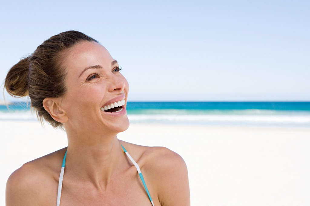 Woman laughing at the beach